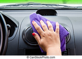 Woman's hand with microfiber cloth polishing  a car