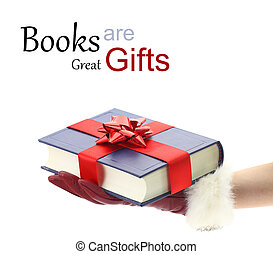 Woman's hand with red glove holding a book for gift
