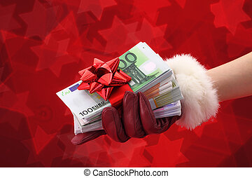 Woman's hand with red glove holding gift of money