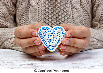 Woman's hands holding a cookies. holiday cookies