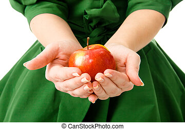 Woman's hands holding a fresh apple