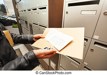 Woman's hands holding envelopes with copy-space