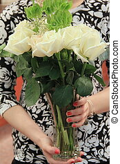 Woman's hands holding roses