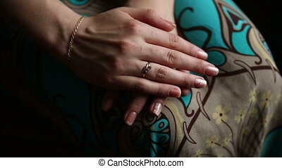 Womans Hands on a Lap - Womans hands with ring on a lap