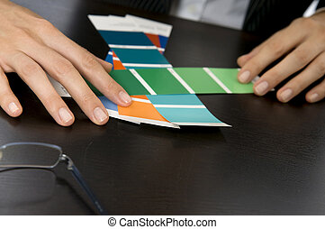Woman\'s Hands Picking Out Swatches