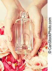 woman's hands showing perfume