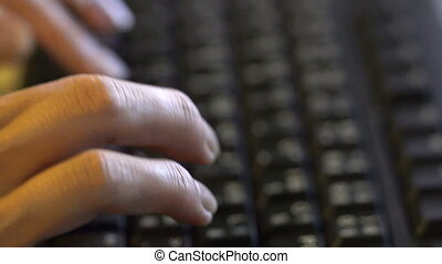 Woman's hands typing on the keyboard