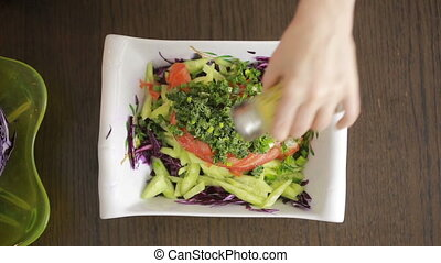 woman's hands with a knife cut red cabbage salad