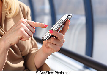 woman`s hands with pda