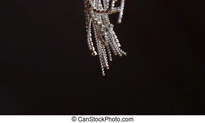 Woman's jewelry earrings waving slowmotion