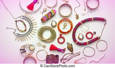Woman's jewelry flat lay composition. Necklaces, earrings, rings and bracelets. Top view.