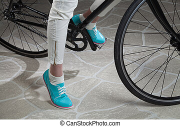 Woman's Legs And Bicycle