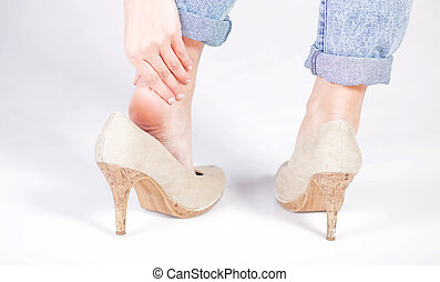 Woman's legs, ankle pain in high heels