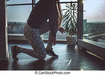 Woman's legs in a grey sport pants.