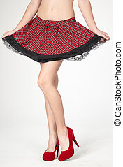 Woman's Legs in High Heels and Short Red Plaid Skirt