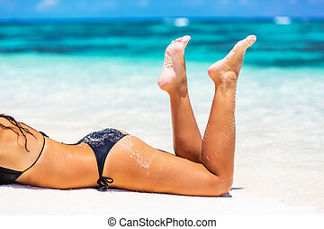 Woman's legs on the beach - Beautiful woman's legs on the...