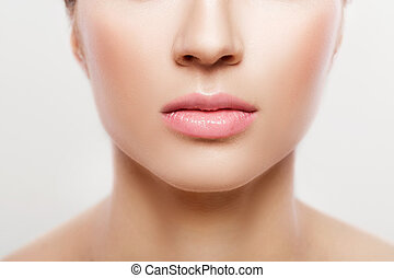 woman's lips with natural make up on white background, close...