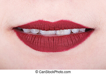 womans lips with red glossy lipstick