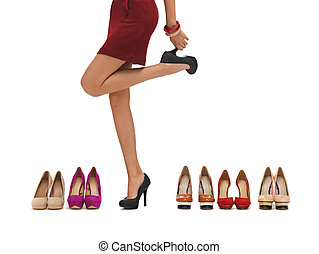 woman's long legs with high heels