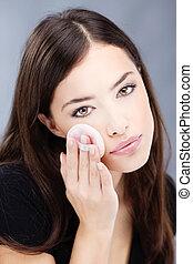 woman's make up - pretty woman applying make up