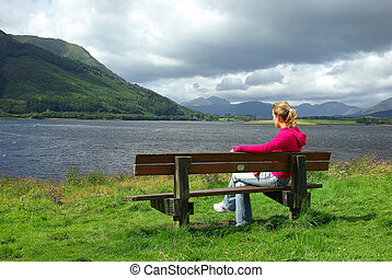 Woman's meditation 1 - Woman sat on a bench and looking at ...