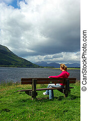 Woman's meditation 2 - Woman sat on a bench and looking at ...