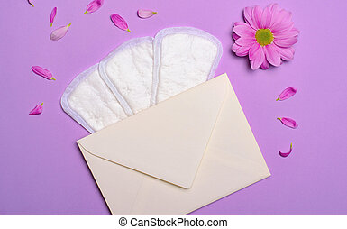 Woman's Sanitary Pads, Envelope and Gerbera Daisy Flower, Feminine Hygiene Concept