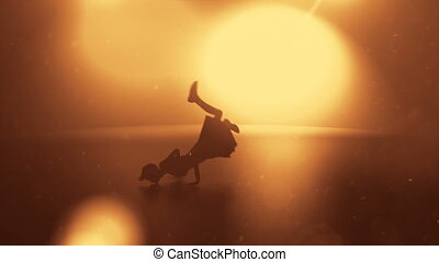 Woman's silhouette performing a dance routine. - Highly...