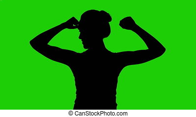 Woman's silhouette with hands up on green background