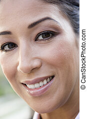 Woman\'s smiling face outdoors (selective focus)