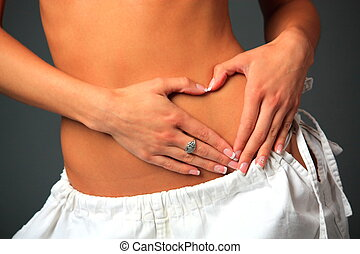 Womans Stomach - Hart shape on womans stomach