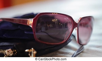 Woman's sunglasses on table closeup