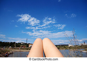 Woman's thighs tanning on Ukraine beach