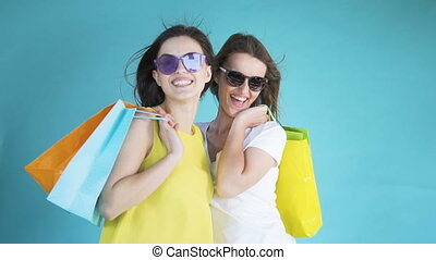Women after Shopping - Thrilled beautiful women holding lots...