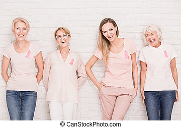 Women against white brick wall