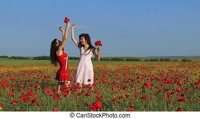 Women among poppy flowers