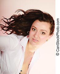 Portrait of sexy brunette girl long hair on pink