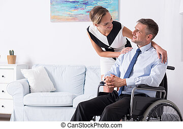 Women and her partner on wheelchair