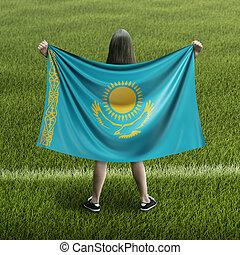Women and Kazakh flag