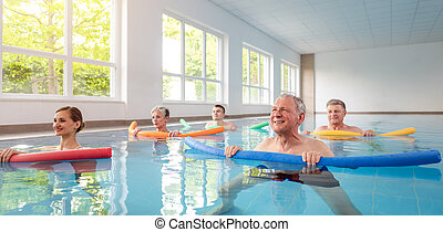 Women and men in water exercises during remobilization