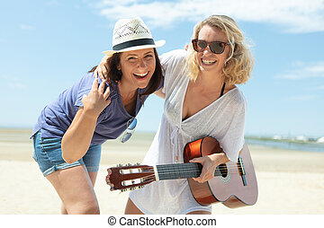 women are on the beach