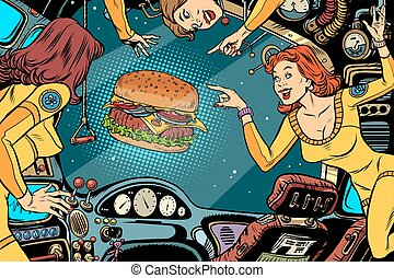 Women astronauts in the cabin of a spaceship and Burger fast food. Vintage comics pop art retro color illustration