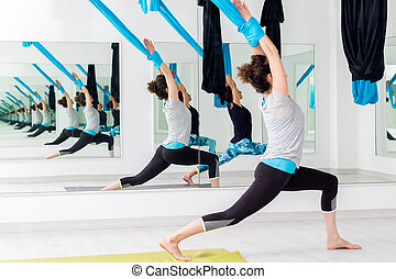 Women at anti gravity yoga session.