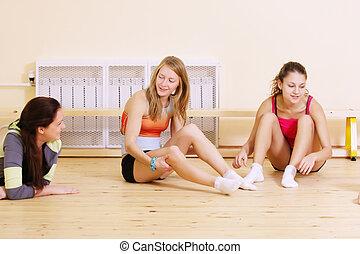 Women at break in gym