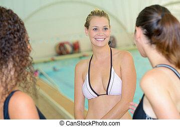 Women at indoor swimming pool