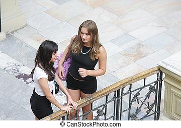 Women at rusty hand-rail