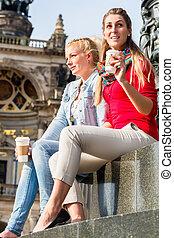 Women at Semper opera in Dresden - Women sitting in front of...