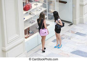 Women at shoe shop window