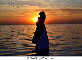Women at sunset.