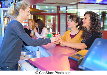 Women being served at bar